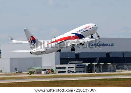 SEPANG, MALAYSIA - AUGUST 5: Malaysia Airline plane Boeing 737-800, Registration name 9M-MXI, take-off at KLIA airport on August 5, 2014 in KLIA, Sepang, Malaysia.  - stock photo