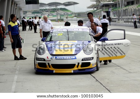 SEPANG, MALAYSIA - DECEMBER 5: Blue Girl's racing crews pushed the car to the garage during the MHH Super Series Round 5 on December 5, 2009 in Sepang, Malaysia - stock photo