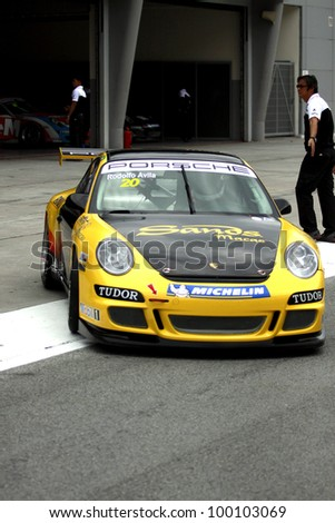 SEPANG, MALAYSIA - DECEMBER 5:Unidentified driver from Sands Macao's team making his way to the main track during the MHH Super Series Round 5 on December 5, 2009 in Sepang, Malaysia - stock photo