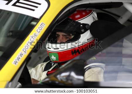 SEPANG, MALAYSIA - DECEMBER 5: Unidentified driver standby in the car during the MHH Super Series Round 5 on December 5, 2009 in Sepang, Malaysia - stock photo