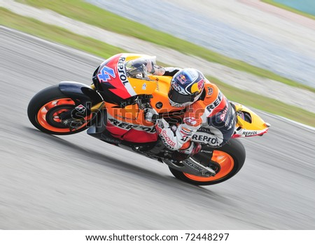 SEPANG, MALAYSIA-FEB 24: Andrea Dovizioso of Repsol Honda Team at MotoGP Official Test Sepang 2 on Feb 24, 2011 in Sepang, Malaysia. - stock photo