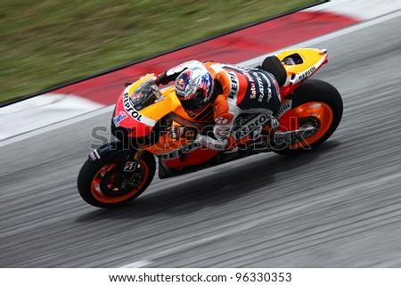 SEPANG, MALAYSIA - FEB 28 - Casey Stoner (Australia)  from the Repsol Honda Team during the  second Official MotoGP test of the 2012 season on Feb 28,1012 in Sepang, Malaysia - stock photo