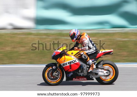 SEPANG, MALAYSIA - FEB 24: Casey Stoner of Repsol Honda Team at MotoGP Official Test Sepang 2 on February 24, 2011 in Sepang, Malaysia. - stock photo