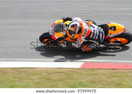 SEPANG, MALAYSIA - FEB 24: Dani Pedrosa of Repsol Honda Team at MotoGP Official Test Sepang 2 on February 24, 2011 in Sepang, Malaysia. - stock photo
