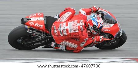 SEPANG, MALAYSIA - FEB. 25 : Ducati Marlboro Team rider Casey Stoner of Australia takes a corner during the 2010 pre-season test at Sepang circuit February 25, 2010 in Sepang, Malaysia. - stock photo