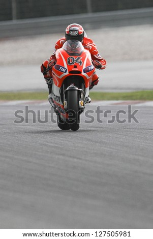 SEPANG, MALAYSIA-FEB 7: Italy No. 4 Andrea Dovizioso of Ducati Team at MotoGP Official Test Sepang 1 on Feb 7, 2013 in Sepang, Malaysia. Season 2013 will start in Qatar on April 7. - stock photo