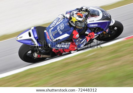SEPANG, MALAYSIA-FEB 24: Jorge Lorenzo of Yamaha Factory Racing at MotoGP Official Test Sepang 2 on Feb 24, 2011 in Sepang, Malaysia. - stock photo