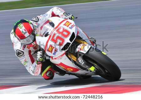 SEPANG, MALAYSIA-FEB 24: Marco Simoncelli of San Carlo Honda Gresini at MotoGP Official Test Sepang 2 on Feb 24, 2011 in Sepang, Malaysia. - stock photo