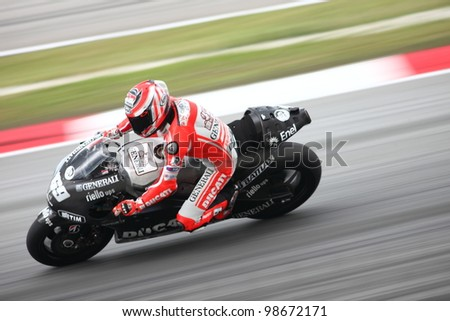 SEPANG, MALAYSIA - FEB 28 : Nicky Hayden (USA) from the Ducati Team in action during the second Official MotoGP test of the 2012 season on Feb 28, 2012 in Sepang, Malaysia - stock photo