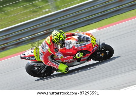 SEPANG, MALAYSIA-FEB 24: Valentino Rossi of Ducati Marlboro Team at MotoGP Official Test Sepang 2 on Feb 24, 2011 in Sepang, Malaysia. - stock photo