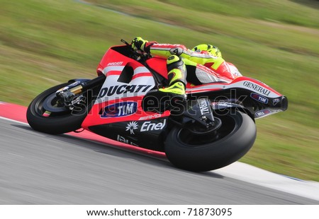 SEPANG, MALAYSIA-FEB 24: Valentino Rossi of Ducati Marlboro Team takes a corner at MotoGP Official Test Sepang 2 on Feb 24, 2011 in Sepang, Malaysia. - stock photo