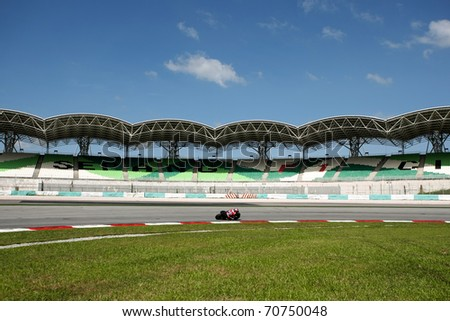 SEPANG, MALAYSIA - FEBRUARY 2: A MotoGP rider rides on the track during the practice sessions of the 2011 MotoGP winter tests at the Sepang International Circuit. February 2, 2011 in Malaysia.
