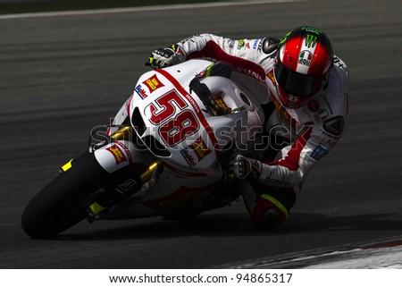 SEPANG,MALAYSIA-FEBRUARY 22: Italian Marco Simoncelli of of San Carlo Honda Gresini Team during pre-season test, February 22, 2011 in Sepang, Malaysia.  He died during Malaysia MotoGP Oct. 23, 2011. - stock photo