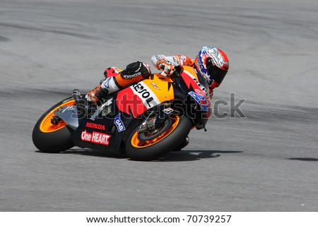 SEPANG, MALAYSIA - FEBRUARY 2: MotoGP rider Casey Stoner of the Repsol Honda Team practices at the 2011 MotoGP winter tests at the Sepang International Circuit. February 2, 2011 in Malaysia.