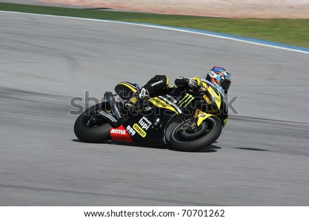 SEPANG, MALAYSIA - FEBRUARY 2: MotoGP rider Colin Edwards of Monster Yamaha Tech 3 Team practices at the MotoGP winter tests at the Sepang International Circuit on February 2, 2011 in Malaysia.
