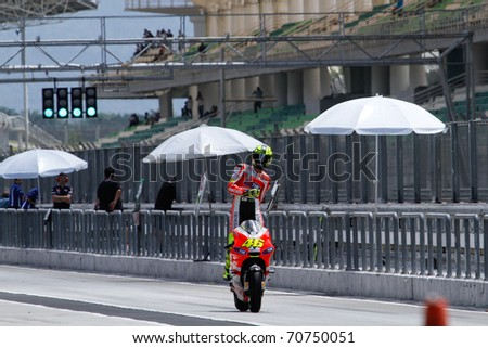 SEPANG, MALAYSIA - FEBRUARY 2: MotoGP rider Valentino Rossi of the Ducati Malboro Team begins his run at the 2011 MotoGP winter tests at the Sepang International Circuit. February 2, 2011 in Malaysia