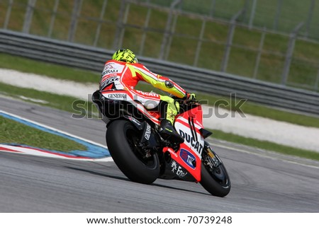 SEPANG, MALAYSIA - FEBRUARY 2: MotoGP rider Valentino Rossi of the Ducati Malboro Team practices at the 2011 MotoGP winter tests at the Sepang International Circuit. February 2, 2011 in Malaysia.