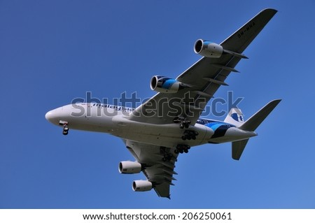 SEPANG, MALAYSIA - JULY 19: Malaysia Airlines plane Airbus A380-841, Registration name 9M-MNA, ready to landing at KLIA airport on July 19, 2014 in KLIA, Sepang, Malaysia.  - stock photo