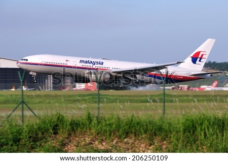 SEPANG, MALAYSIA - JULY 19: Malaysia Airlines plane Boeing 777-2H6ER, Registration name 9M-MRC, landing at KLIA airport on July 19, 2014 in KLIA, Sepang, Malaysia.  - stock photo
