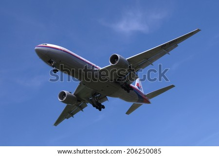 SEPANG, MALAYSIA - JULY 19: Malaysia Airlines plane Boeing 777-2H6ER, Registration name 9M-MRJ, ready to landing at KLIA airport on July 19, 2014 in KLIA, Sepang, Malaysia.  - stock photo