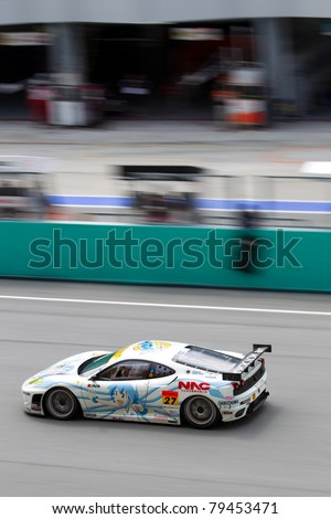 SEPANG, MALAYSIA - JUNE 18: A portrait view of Team LMP Motorsports in their Ferrari f430 going past the pit lane during qualifying at Super GT International series June 18, 2011 in Sepang, Malaysia - stock photo