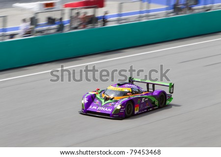 SEPANG, MALAYSIA - JUNE 18: Cars Tokai Dream28 team goes past the pit lane during qualifying at Super GT International series June 18, 2011 in Sepang, Malaysia - stock photo