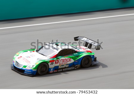 SEPANG, MALAYSIA - JUNE 18: Lexus Team Kraft goes down the high speed main straight during qualifying at Super GT International series June 18, 2011 in Sepang, Malaysia - stock photo