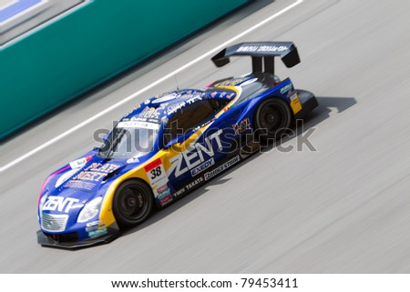 SEPANG, MALAYSIA - JUNE 18: Lexus team Zent goes down the high speed main straight during qualifying at Super GT International series June 18, 2011 in Sepang, Malaysia - stock photo