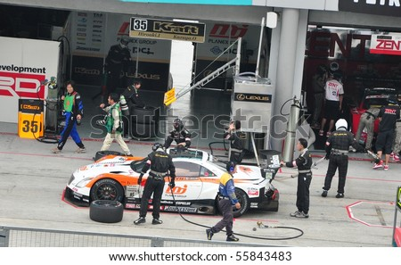 SEPANG, MALAYSIA - JUNE 20 : Pit Stop Crews do inspection during the Super GT International Series, Round 4 on June 20, 2010 in Sepang International Circuit, Malaysia. - stock photo