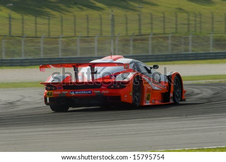 Sepang, Malaysia - June 20, 2008: Rear view of a car from Team Arta NSX during practice session at Super GT Malaysia Championship 2008. - stock photo