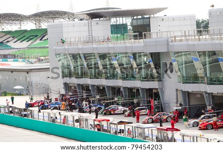 SEPANG, MALAYSIA - JUNE 18: SuperGT cars line up to start qualifying at the Super GT International series June 18, 2011 in Sepang, Malaysia - stock photo
