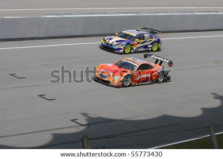 SEPANG, MALAYSIA - JUNE 20 : SuperGT driver in actions during the Malaysian 10th edition of SuperGT International Series on June 20, 2010 in Sepang F1 circuit outside Kuala Lumpur, Malaysia - stock photo