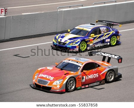 SEPANG, MALAYSIA - JUNE 20 : SuperGT drivers in battle for position during the Super GT International Series, Round 4 on June 20, 2010 in Sepang International Circuit, Malaysia. - stock photo
