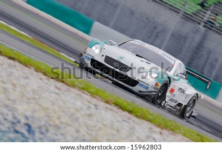 Sepang, Malaysia - June 22, 2008: Team PETRONAS Tom's SC430 in action at race day at Super GT Malaysia Championship 2008 - stock photo