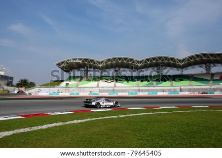 SEPANG, MALAYSIA - JUNE 19: Team R'Qs Motorsport's Vemac 350R car takes turn 1 of the Sepang International Circuit during a practice run of the Japan SUPER GT Round 3 race on June 19, 2011 in Sepang, Malaysia. - stock photo