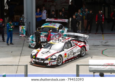 SEPANG, MALAYSIA - JUNE 18: Team SG Changi in their Lexus exits their pit box during qualifying at Super GT International series June 18, 2011 in Sepang, Malaysia - stock photo
