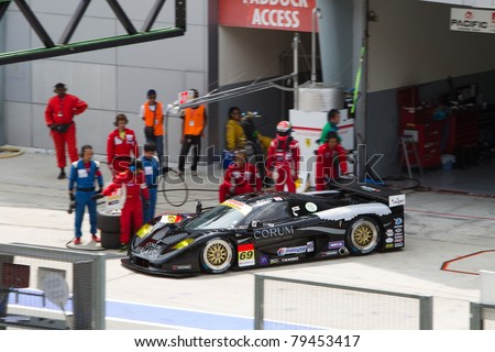SEPANG, MALAYSIA - JUNE 18: Team Thunderasia Racing in their Mosler car exits their pit box during qualifying at Super GT International series June 18, 2011 in Sepang, Malaysia - stock photo