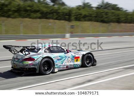 SEPANG, MALAYSIA - JUNE 10: Team Ukyo in their BMW Z4 leaves the pitlane at Super GT Race June 10, 2012 in Sepang, Malaysia - stock photo