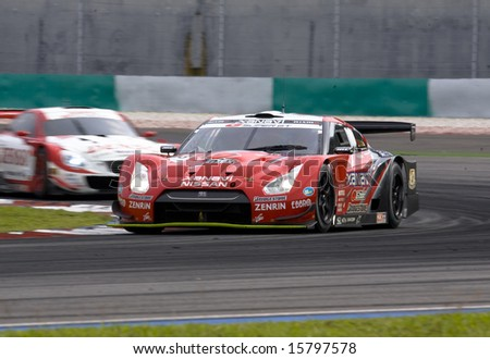 Sepang, Malaysia - June 22, 2008: Team Xanavi Nismo GT-R in action at Super GT Malaysia Championship 2008. - stock photo