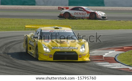 Sepang, Malaysia - June 22, 2008: Team Yellowhat YMS Tomica GT-R in action during race dat at Super GT Malaysia Championship 2008. - stock photo