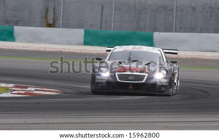 Sepang, Malaysia - June 22, 2008: Team Zent Cerumo SC430 during race day at Super GT Malaysia Championship 2008 - stock photo