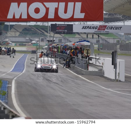 Sepang, Malaysia - June 22, 2008: Team Zent Cerumo SC430 in action at Super GT Malaysia Championship 2008 - stock photo
