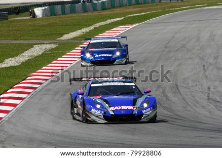 SEPANG, MALAYSIA - JUNE 18: The Honda HSV-010 car of Team Kunimitsu puts in some practice laps in the Sepang International Circuit at the Japan SUPER GT Round 3 on June 18, 2011 in Sepang, Malaysia. - stock photo