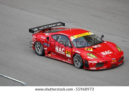 SEPANG, MALAYSIA - JUNE 21: The NAC Eiseicom LMP Ferrari car (27) on the tracks at the Super GT International Series Round 4 race. June 21, 2010 in Sepang Malaysia.