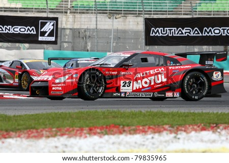 SEPANG, MALAYSIA - JUNE 18: The Nissan GTR car of NISMO team spins during early practice in the Sepang International Circuit during the Japan SUPER GT Round 3 on June 18, 2011 in Sepang, Malaysia.