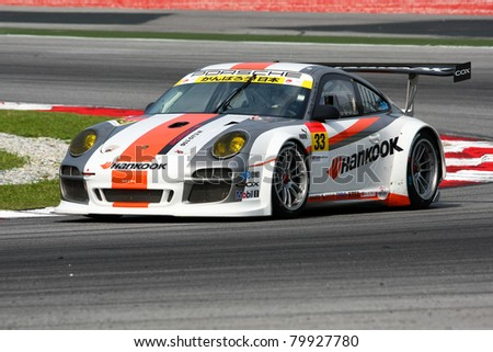 SEPANG, MALAYSIA - JUNE 18: The Porsche 911 car of Hankook KTR puts in some practice laps in the Sepang International Circuit at the Japan SUPER GT Round 3 on June 18, 2011 in Sepang, Malaysia. - stock photo