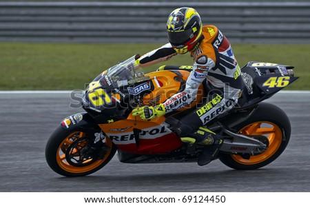 SEPANG, MALAYSIA - KUALA LUMPUR, MALAYSIA - OCTOBER 10: Valentino Rossi of Italy in action during the Malaysian MotoGP October 10, 2003 at Sepang International Circuit near Kuala Lumpur, Malaysia. - stock photo