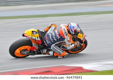 SEPANG,MALAYSIA-MARCH 1:Australian Casey Stoner of Repsol Honda Team at 2012 MotoGP Official Winter Test Sepang 2 on Mar. 1, 2012 in Sepang, Malaysia.The 2012 MotoGP season starts on April 8 in Qatar. - stock photo