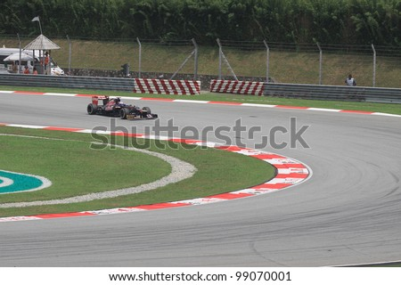 SEPANG, MALAYSIA - MARCH 23: Australian Daniel Ricciardo of Toro Rosso-Ferrari in action during Friday practice at Petronas Formula 1 Grand Prix on March 23, 2012 in Sepang, Malaysia - stock photo