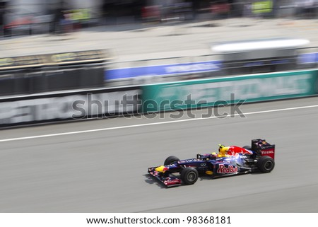 SEPANG, MALAYSIA - MARCH 23: Australian Mark Webber of Team Red Bull goes down the main straight during Friday practice at Petronas Formula 1 Grand Prix March 23, 2012 in Sepang, Malaysia - stock photo